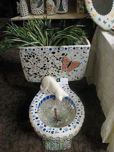 Wow, this artist did a beautiful job! Recycled toilet