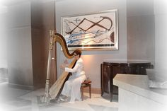Four Seasons Miami is a perfect venue for and special event, Florida harpist Esther Underhay performs for Baptism reception in private dining room. Photographer Sergio Dancam