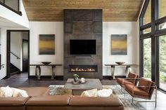 A rustic-contemporary lake house was designed by Alexander Design Group, and built by Denali Custom Homes, set on Lake Minnetonka, Minnesota. Modern Lake House, Modern Mountain Home, Indoor Outdoor Fireplaces, Linear Fireplace, Fireplace Wall, Rustic Contemporary, Contemporary Homes, Modern Homes, Modern Rustic