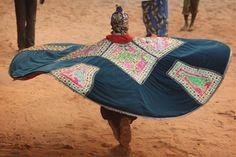 An 'Egungun' spirit performs during a Voodoo ceremony in Ouidah, Benin. | Getty Images
