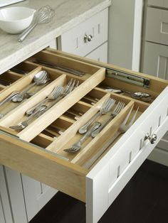 everything in its right place! sliding, double stacked kitchen drawer organizers. Nifty!