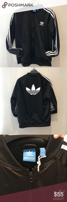 Size medium Adidas jacket BNWOT Size medium long sleeve Adidas jacket with three stripes and the old school adidas emblem large printed sign on the back Adidas Jackets & Coats Utility Jackets