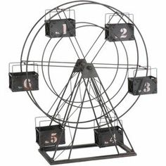"""Black-finished Ferris wheel decor with numeral accents.         Product: Decor    Construction Material: Metal       Color: Black      Dimensions: 26"""" H x 22"""" W x 8"""" D"""