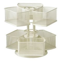 Wire mesh organizing carousel with multiple compartments. Lazy Susan base rotated 360-degrees. Product: Cosmetic carouselConstruction Material: Powder-c...
