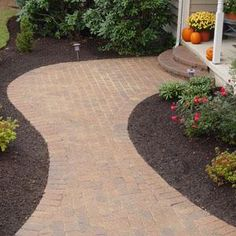 Use brick pavers to create a new walkway in front of the house.