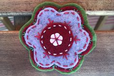 Felt ornament with hand made stiched detail. Christmas Settings, Felt Ornaments, Flower Brooch, Felt Flowers, Gift Bags, Christmas Time, Create Yourself, Etsy Seller, Detail