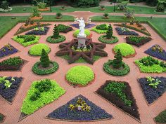 Hardscape and intricately designed garden beds mingle at the Kresko Family Victorian Garden, located at Missouri Botanical Garden in St. Louis.