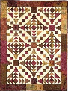 "Combine traditional ""54 40 or Fight"" and ""Goose Chase"" blocks to create this beautiful wall or lap quilt showcasing curves but made using only straight seams. Designed by Carolyn Griffin for Far-Flung Quilts. Looks a lot like Faceted Jewels by Glad Creations."