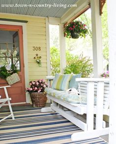 Sprucing up the front porch with a flea market glider and new cushions.