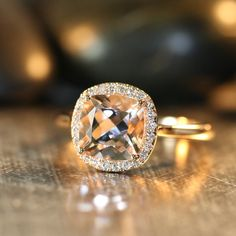 This elegant and feminine Morganite ring features a 8x8mm cushion cut pinkish peach natural Morganite surrounded by sparkling conflict free natural