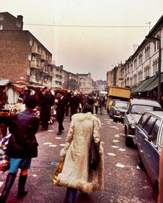 Portobello Road, street our flats on the left.Oh H E double hockey sticks, I had a coat like that. Vintage London, Old London, West London, Notting Hill London, London Market, Swinging London, London History, London Pictures, Portobello