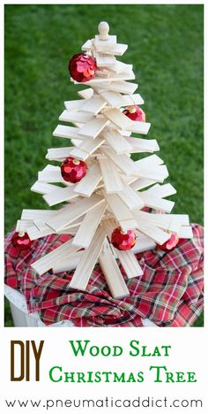 Learn to make your own DIY Wood Slat Christmas Tree. Tutorial and cut list found at www.pneumaticaddict.com