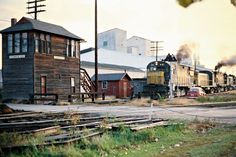 CNW, Winona, Minnesota, 1977 Westbound Chicago and North Western Railway freight train receiving orders at Tower CK in Winona, Minnesota, on October 1, 1977. Photograph by John F. Bjorklund, © 2015, Center for Railroad Photography and Art. Bjorklund-25-22-13.