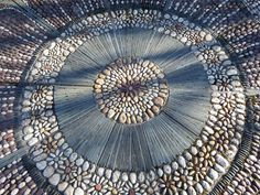 The centre of the Maggy Howarth mosaic at the Lancashire Rose. Stone Garden Paths, Garden Paving, Garden Stepping Stones, Stone Path, Pebble Stone, Pebble Mosaic, Stone Mosaic, Pebble Art, Mosaic Art