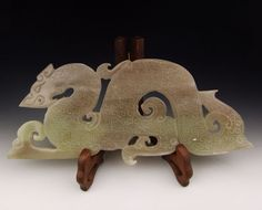 Dragon shaped jade carving from Spring & Autumn Period.