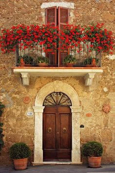 "Gypsy Purple home...... ""Montisi, Tuscany - Italy.""  That patio and those red flowers remind me of the one in ""Under the Tuscan Sun""."
