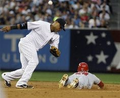 Game #87 7/13/12: Los Angeles Angels' Mike Trout steals second base as New York Yankees second baseman Robinson Cano loses control of the ball during the third inning of a baseball game, Friday, July 13, 2012, in New York. (AP Photo/Frank Franklin II)