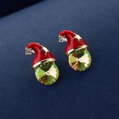 Santa earrings for girls and women. Santa claus jewellery for christmas and casual wear. Santa statement earrings fashion online. Red enamel and green crystal earrings from Blingvine Jewelry Online Store. Crystal Earrings, Statement Earrings, Women's Earrings, Cute Floral Dresses, Crisp White Shirt, Floral Necklace, Necklace Online, Girls Earrings, Christmas Jewelry