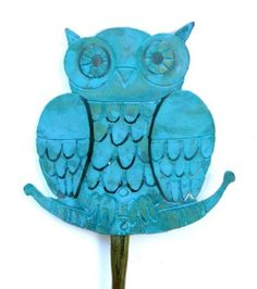 "Owl Original Brass Plant Stake with Patina Finish for Garden and Planters Handmade in USA by Aurna Enterprises. $25.00. Size: Owl is 2 1/2"" wide x 2 1/4"" tall. Stake is 17 1/2"" long. Hand Crafted in USA by American Artist Barbara W. Stanger. These plant stakes are made in our studio from original drawings. They are made of etched brass, which is individually dipped into a patina (the stakes themselves are brass without patina). The patina is not a paint; it is a chemical..."
