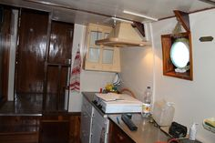 Aft Galley, looking towards the hall leading to the aft head and shower, salon, chart room and the Master cabin.