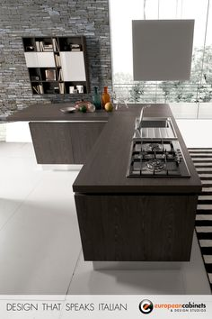 An open kitchen collection with coordinating living room storage cabinets with wood textures and simple, essential lines that remain true to Aran Cucine's artisan craftsmanship.