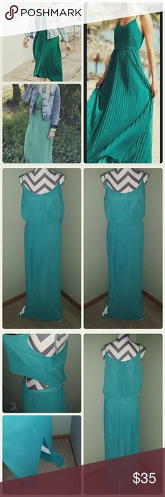 Adorable Teal Maxi This dress is like new, hardly worn floor length maxi. I'm 5'10 and this dress sweeps the floor on me. Has adjustable straps and peekaboo lower back. Has 2 lower side slits as well. It has a liner and is not see through.   Price is firm unless bundled. Bisou Bisou Dresses