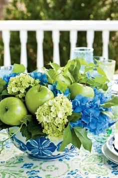 Attached to florist picks, Granny Smith apples bring an affordable flourish to a lush hydrangea centerpiece. Fill in with sprigs of lemon leaf and bittersweet vine greenery for a seamless mix of country elegance and chinoiserie chic.     SourcesFlower arrangement: Southern Blooms by Pat's Floral Designs