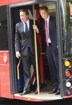 Britain's Prince Harry(R) and British Prime Minister David Cameron arrive at Milk Studio aboard a double decker bus in New York, 14 May 2013