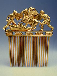 Gold comb with Scythians in battle, 5th-4th centuries BC. This comb recalls the facade of a Greek temple with a colonnade made up of its 12 teeth, a triangular fronton with three battling warriors, and a frieze of five reclining lions. Excavated in 1913 at Solokha Barrow, Ukraine.