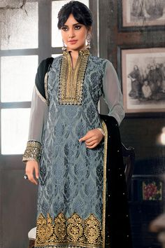 Get Bold look with Zari work and Dark Grey Embroidery...