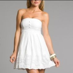 Romantic sexy white voile lace strapless dress Perfect for vacay to a warm place or even a casual beach wedding dress! Has a lining (so not see thru) and skirt part has a layer of tule and then top lace layer for great flowing body! Pearly white buttons on bust with crochet accent. Tie around waist for a sweet bow in back! And side zip. City Triangles brand size 5 NWT. Fits 32 A/B - 34 A/B. City Triangles Dresses Strapless