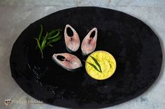 Ilish Paturi  - Ilish steamed in mustard, coconut and poppy seed paste wrapped in banana leaves / Steamed hilsha the raw produce
