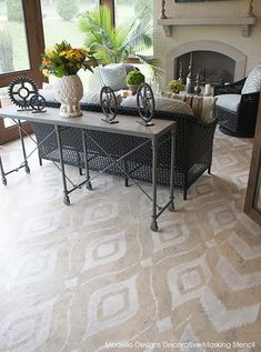 A custom Ikat Chevron Modello™ Designs vinyl stencil pattern is used with the Skimstone concrete floor. The beautiful exterior patio was part of the Nashville Southern Living Showcase Home. Artistry by Bella Tucker. www.ModelloDesigns.com