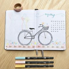 Bullet journal monthly cover page, May cover page, bicycle drawing, washi tape. | @amber.journals