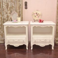 "What a stunning pair of nightstands! Features an open shelf and one drawer. The drawer has rose appliques and clear, glass knobs decorating the face.Features curvy feet. Great for any shabby chic style bedroom.  23""w x 16""d x 24.5""t"