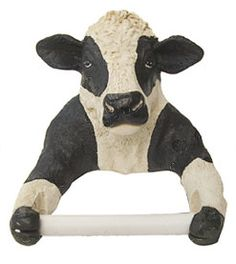 A cow toilet paper holder! How cool is that? Sitting there, doing your business, and you reach for your little cow friend for an assist! Must have for the guest bathroom...
