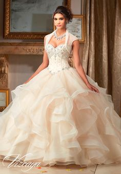 Beautiful and magnificent, make a lasting impression wearing Mori Lee Vizcaya Quinceanera Dress Style 89107 at your Sweet 15 party. Made out of organza, this Quince dress features a strapless bodice d