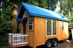 This is such a wonderful Tiny House plan! 2 lofts, staircase with storage cabinets, a tub (!), a skylight that opens, and a double-dutch front door! There's also a fire escape back door and a lot of great information on building to move and using solar power.