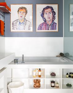Above the tub, portraits of Belden and Re by artist Don Bachardy.