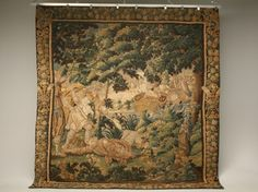 This wool and silk tapestry was woven in France in the 1600s and is documented. It has its original floral border and beautiful verdure and classical motifs. Completely handmade and all authentic. Needs minor restoration.