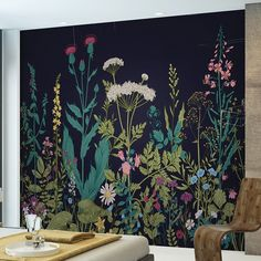 Create a stunning feature wall in any room of your house with the Botanical Fleur 3.5m x 2.8m Wallpaper Wall Mural. A dramatic design of bright beautiful flowers on a bold dark background giving a floral backdrop with a difference. Botanical fleur is a bold design that would lift any room.