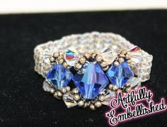 This is a beautiful ring! Hand beaded with seed beads and Swarovski beads.  Approx. a size 10 (non-stretchy) $10 www.facebook.com/ArtfullyEmbellished www.etsy.com/shop/ArtfullyEmbellished