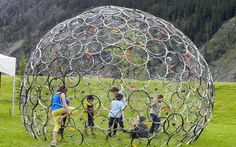 Bicycle wheel dome. Imagine this covered in vines. It would make a nice retreat.