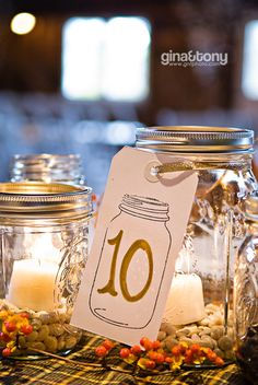 centerpieces - maybe mix pebbles with glass beads within color palette and tie with raffia?  Could also spray paint metal rings or leave them off . . .