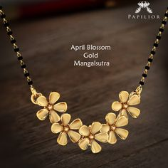 """With love from #Papilior, because the time to shine is Now!"" #mangalsutra #goldmangalsutra #below5000 #flowershapedmangalsutra #gold #shopping"
