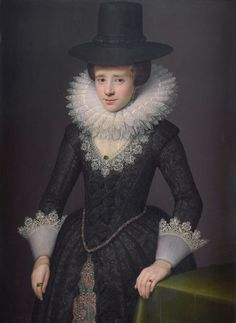 Portrait of Anna Boudaen Courten, wife of Jacob Pergens. Standing, at half length, her left hand leaning on a table. 1619. Attributed to Salomon Mesdach.