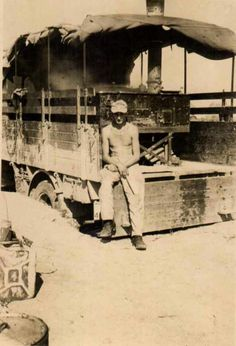 A Afrika Korps soldier posing on a Einheits field kitchen truck while serving in hot desert conditions