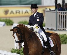 Hiroshi Hoketsu & Whisper - Dressage -Japan.  Hoketsu competed in Beijing 2008 and Tokyo 1964. At 70 he will not be the oldest Olympian ever, there was a 72 year old in 1920.
