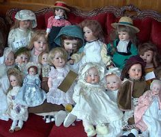 Antique dolls they have their own dresser in my room and no I am not scared of them...the husband is lol!