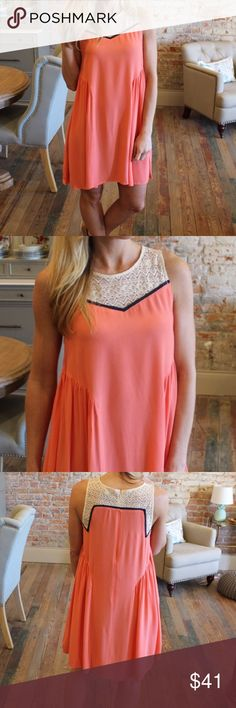 """Coral Sleeveless Dress with Lace Trim Beautiful coral dress with contrasting navy and lace.  60% cotton 40% polyester.  Only size large in stock.  Bust laying flat 21"""".  Length 36"""". Dresses"""
